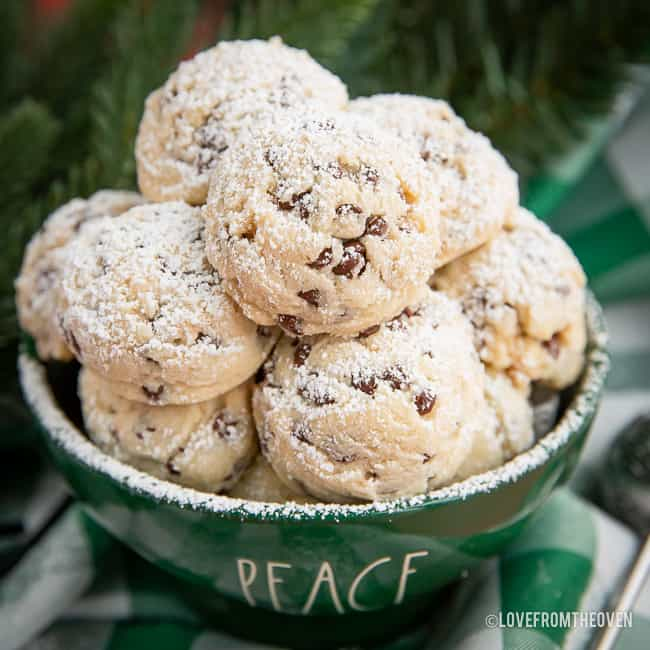 Pile of snowball cookies in a green bowl