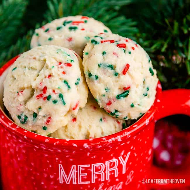 Close up of snowball cookies in a red mug