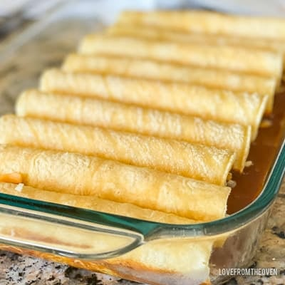 Several enchiladas in a glass baking pan