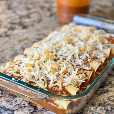 Cheese covered enchiladas in glass baking pan