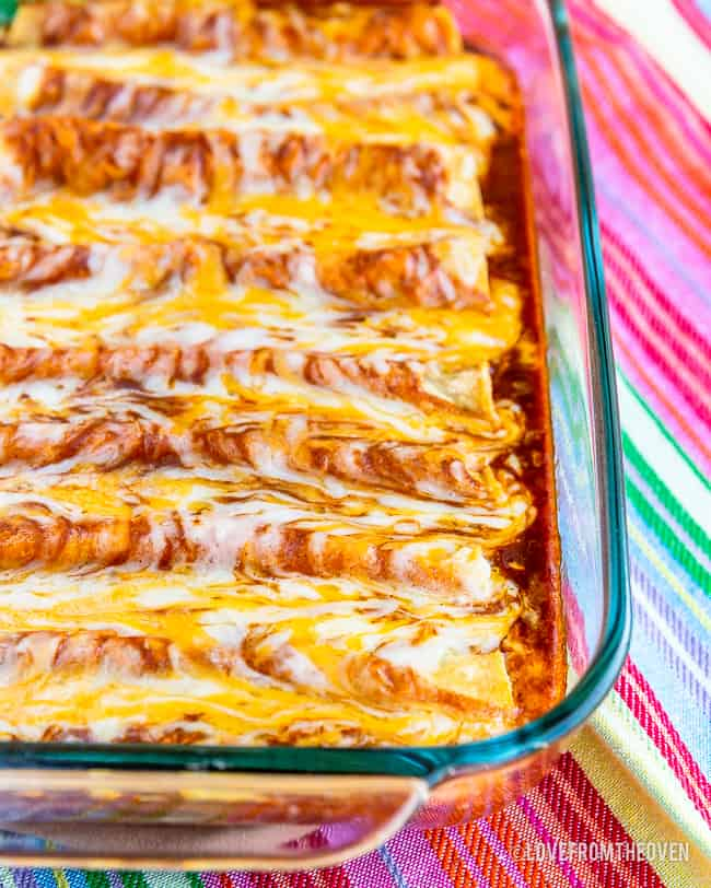 Close up of cheese enchiladas in glass baking pan