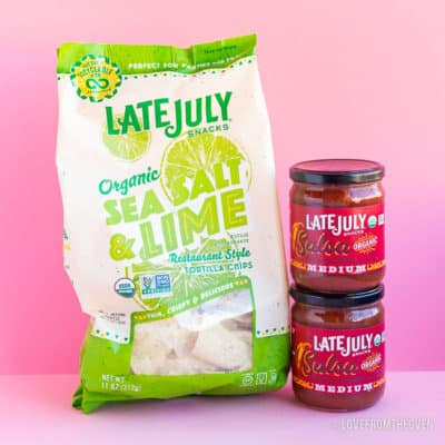 A bag of Late July sea salt and line tortilla chips with two jars of Late July salsa