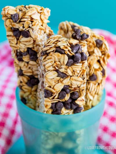 Three chocolate chip granola bars in a blue cup