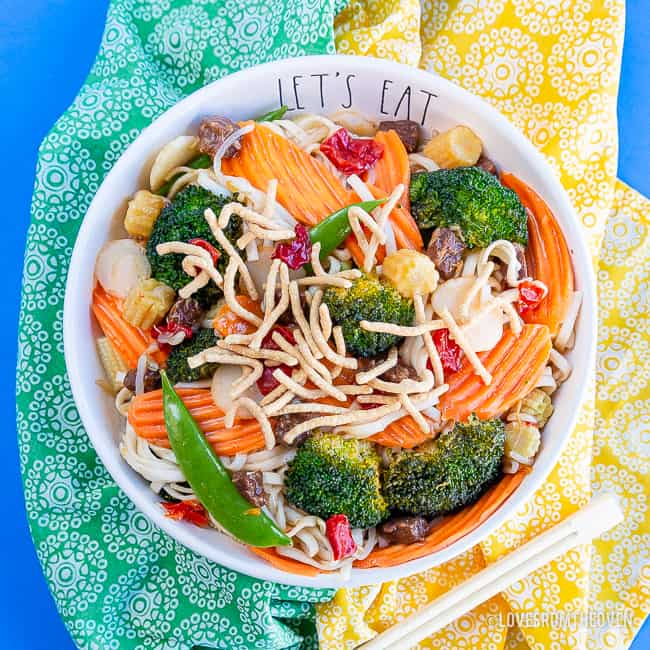 Bowl of chow mein with green and yellow napkins