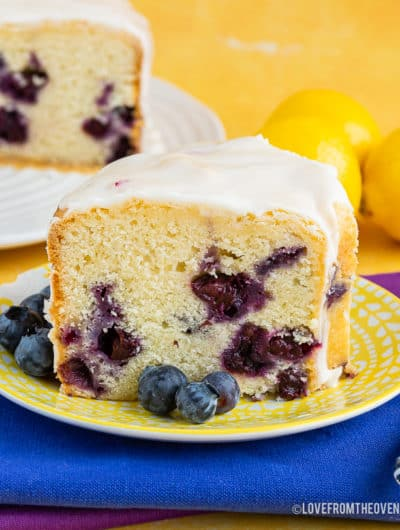 A piece of lemon blueberry cake on a plate,