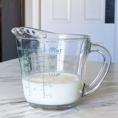 A measuring cup full of milk