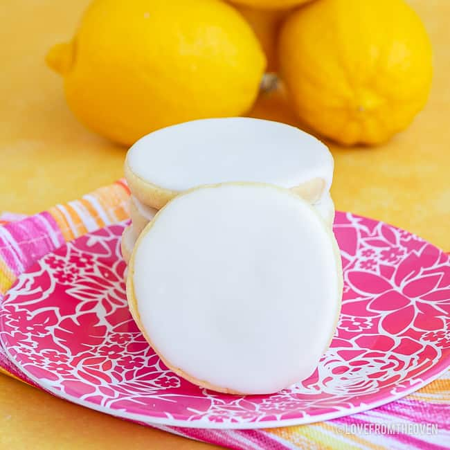lemon cookies on a pink plate