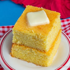 stack of cornbread topped with butter