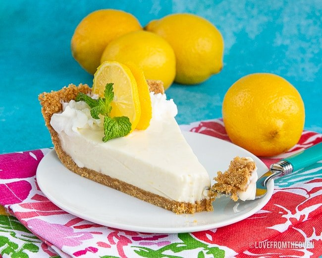 A pie with lemons on a plate