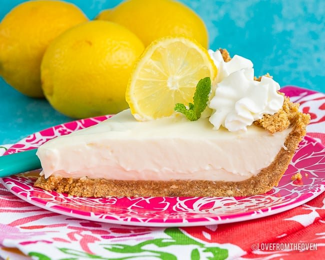 A slice of pie on a plate, with Lemon and Cream