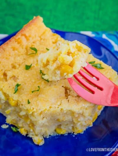 Plate of Jiffy Corn Casserole on a green background