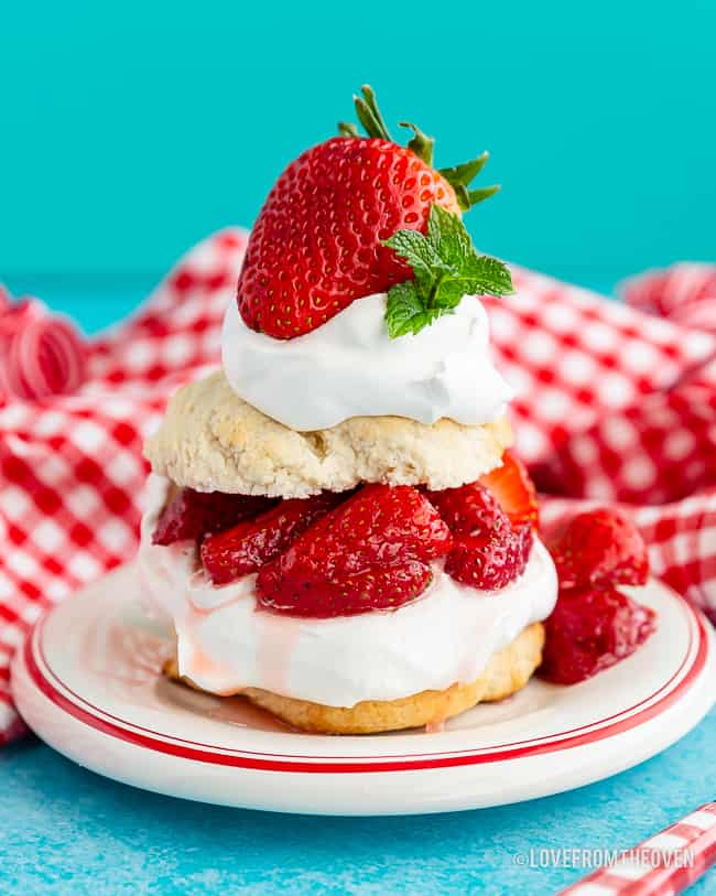 Bisquick strawberry shortcake on a plate with a blue background and red and white napkin