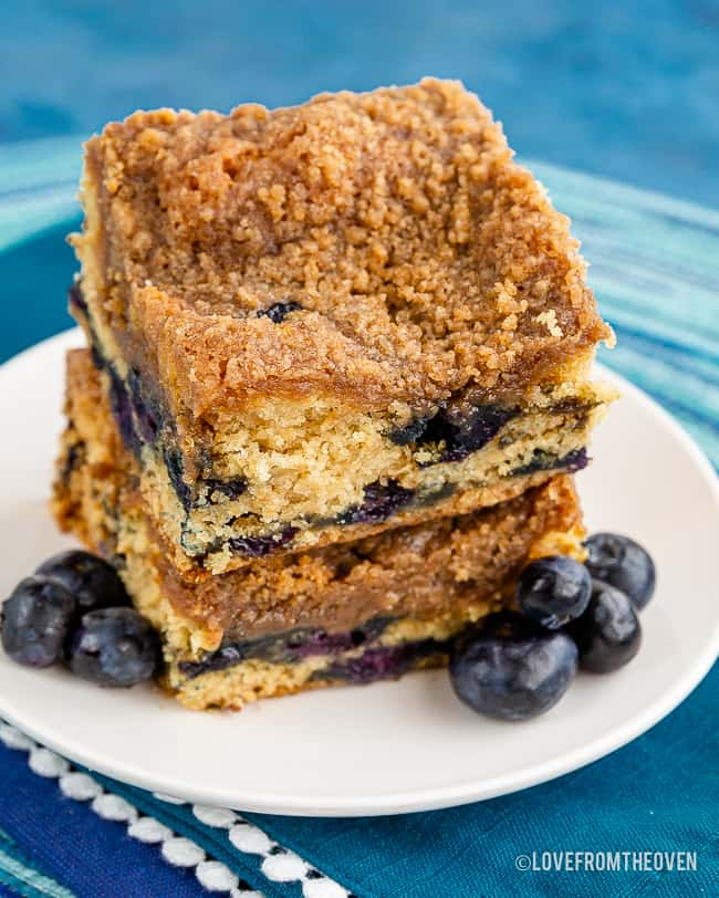 Two slices of blueberry buckle cake stacked on each other