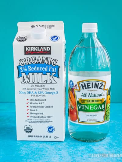 A carton of milk and a bottle of vinegar to make homemade buttermilk