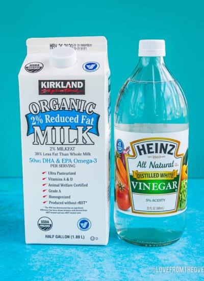 A carton of milk and a bottle of vinegar to make homemade buttermilk