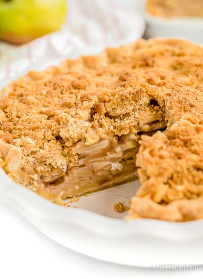A Dutch apple pie with a slice cut out