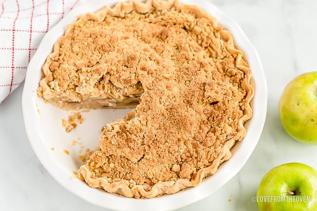 Apple Crumb Pie with one slice cut out
