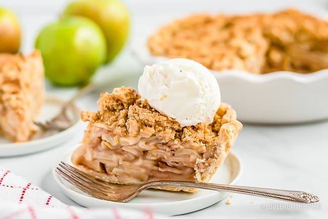 A slice of Dutch apple pie topped with ice cream