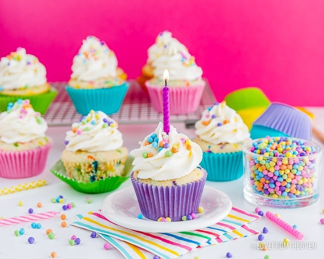 Funfetti cupcakes on a table that is prepared for a party