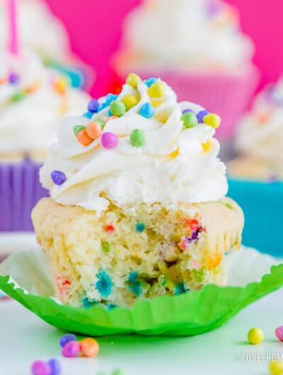 Picture of a funfetti cupcake with a bite taken out of it