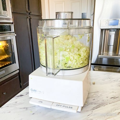 Food processor chopping cabbage for a KFC coleslaw copycat recipe