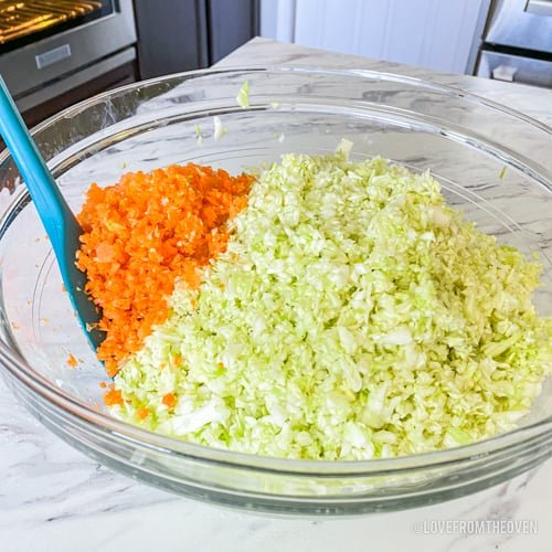 Bowl with cabbage and carrots to make KFC coleslaw at home