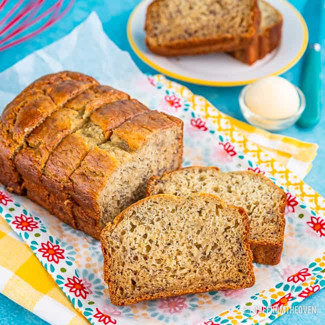 Loaf of banana bread cut into slices ready to serve