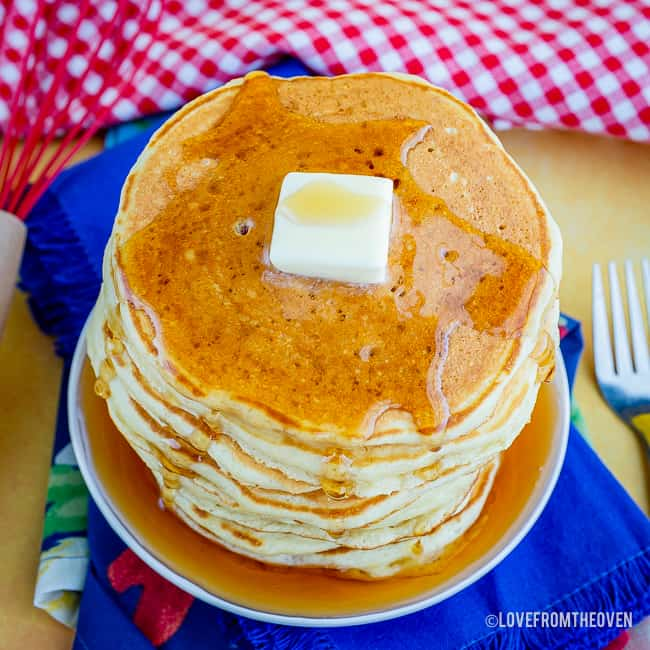 Overhead shot of pancakes topped with butter