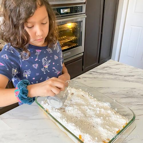 girl making peach dump cake
