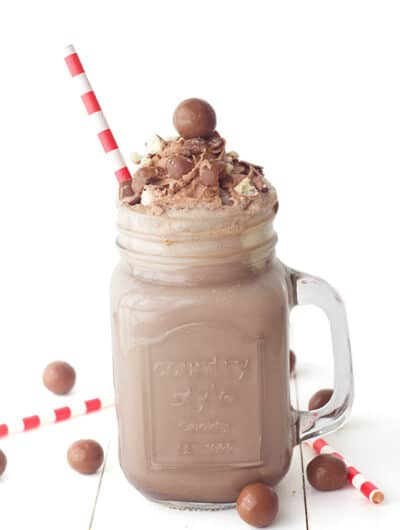 a chocolate malt milkshake with red and white straw