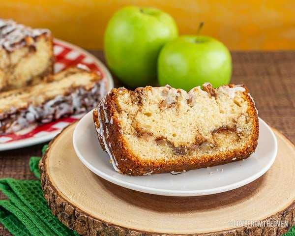 Slices of apple fritter bread in front of apples