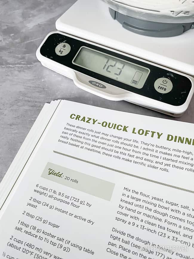Cookbook and food scale on counter