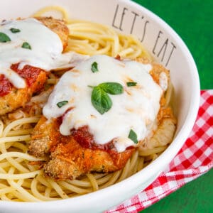 Chicken parmesan in a bowl with pasta