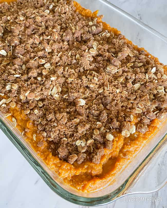 A pan of sweet potato casserole with topping
