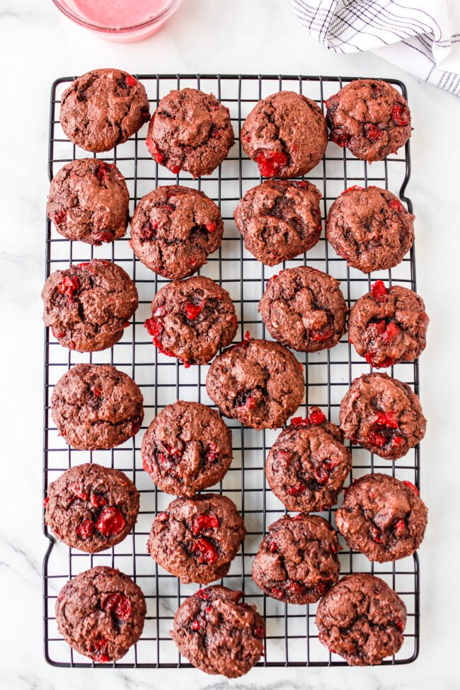 Chocolate cherry cookies on a cooling rack