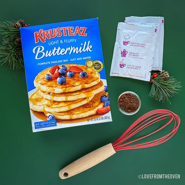 ingredients for pancakes on a green background