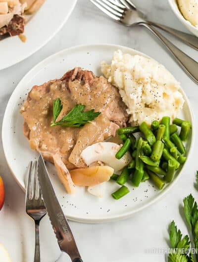 ranch pork chops on a plate with green beans