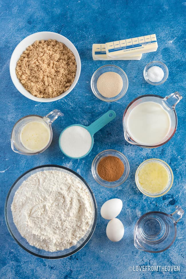 ingredients for cinnamon rolls on a blue background