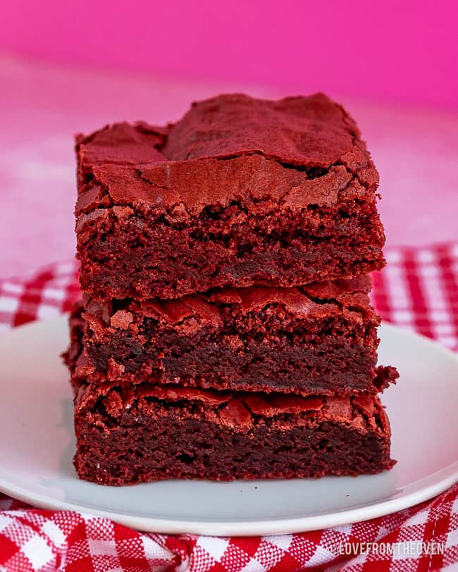 stack of red velvet bars with a pink background