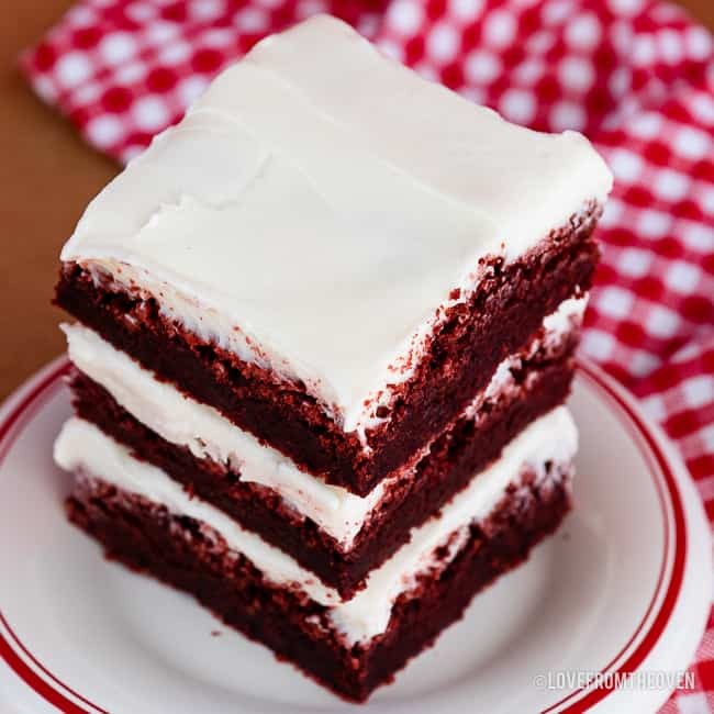 stack of red velvet brownies with cream cheese frosting