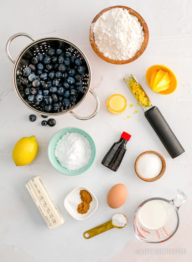 ingredients for lemon blueberry scones on a white background