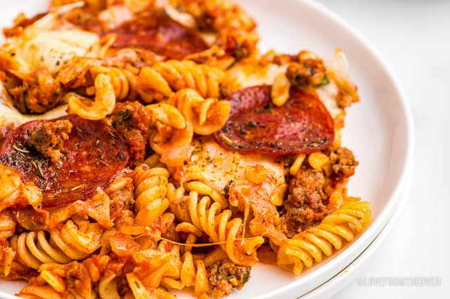 Close up shot of a plate of pizza pasta