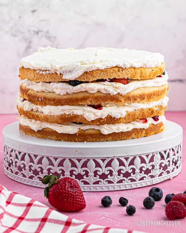 chantilly layer cake on a cake stand