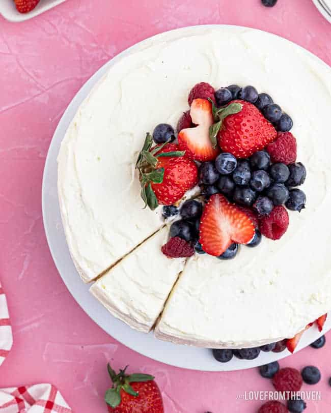 overhead photo of chantilly cake topped with berries