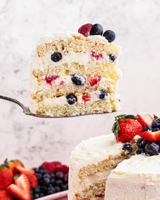 A slice of chantilly cake on a spatula