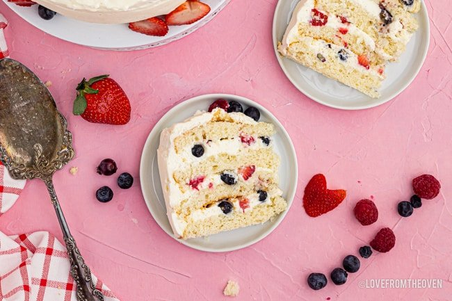 Overhead shot of slices of chantilly cake with fresh berries