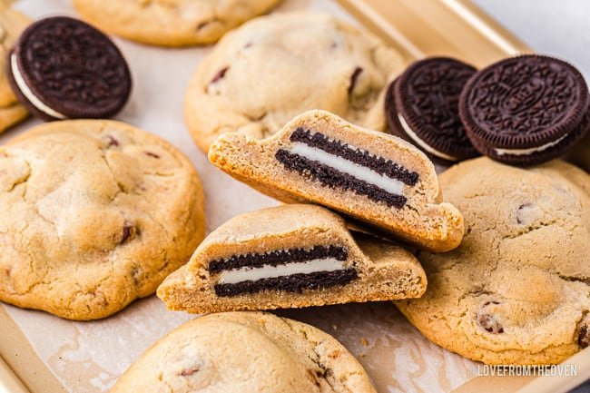 Chocolate chip cookies with oreos inside on a baking sheet