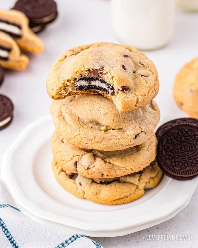 A stack of chocolate chip cookies with oreos inside