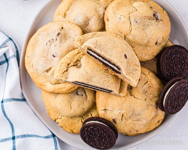 A plate of chocolate chip cookies stuffed with Oreos