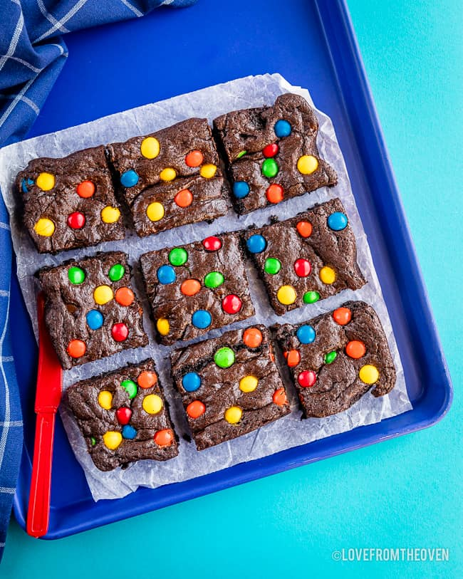 a batch of MM fudge brownies on blue background